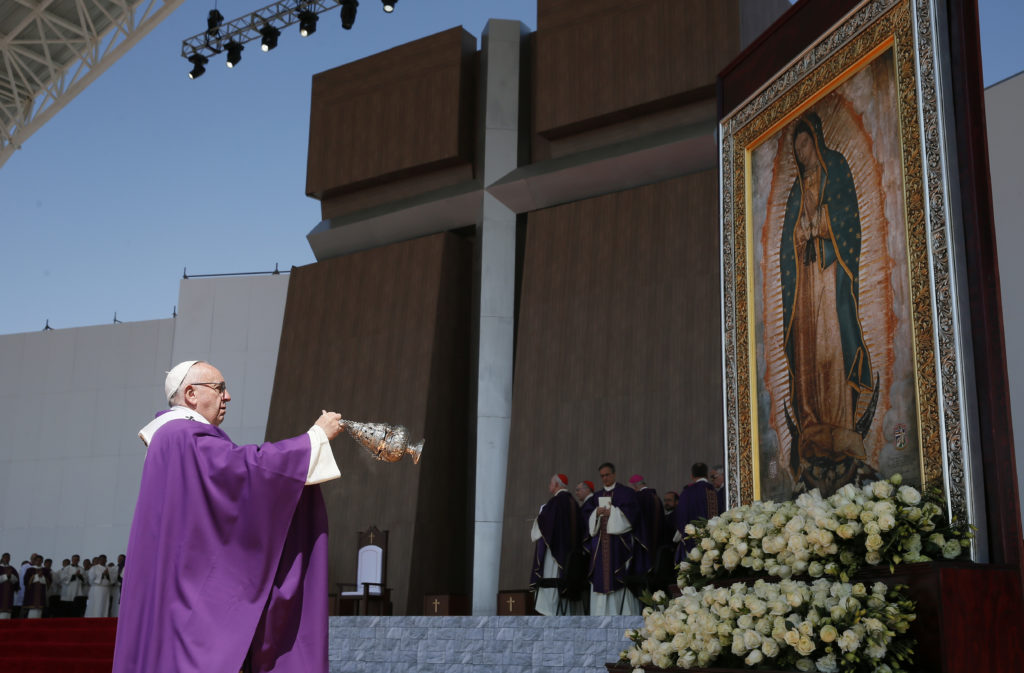 Pope Francis uses incense to venerate an image of Our Lady of Guadalupe during Mass in Ecatepec near Mexico City Feb. 14. (CNS photo/Paul Haring) See POPE-ECATEPEC Feb. 14, 2016.